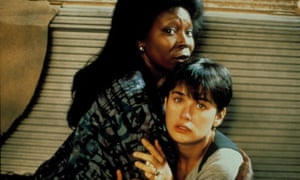 A wise folksy black character: Whoopi Goldberg in Ghost.
