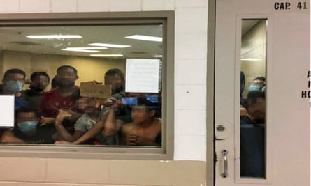 Men detained at a border patrol station in McAllen, Texas