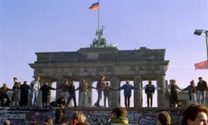 Berliners sing and dance on top of The Berlin Wall to celebrate the opening of East-West German borders, 10 November 1989.