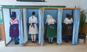 A group of Hungarian women in traditional dress vote in the country's referendum