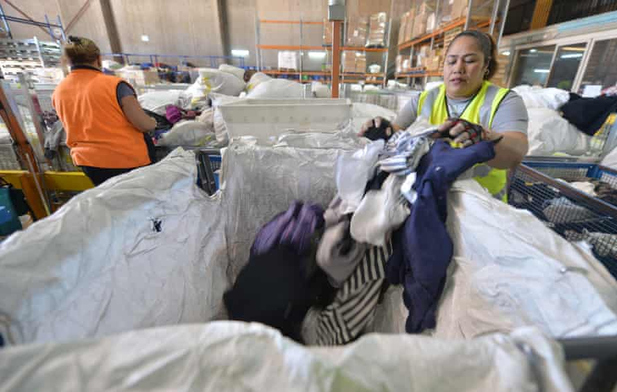 Wworkers sorting out clothing at the St Vincent de Paul Society, a major charity recycling clothes, in Sydney.