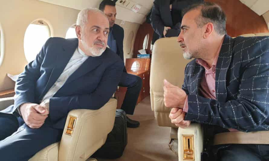 The Iranian foreign affairs minister, Mohammad Javad Zarif, and Masoud Soleiman inside an airplane at an undisclosed airport in Switzerland.