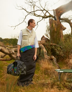 Sleeping bag holdall, POA, by Louis Vuitton. Shirt, £350,  and puffer vest, POA,