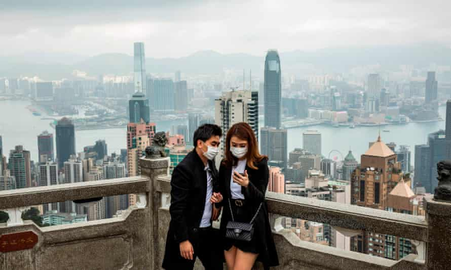 People wearing protective face masks visit the lookout of Victoria Peak in Hong Kong