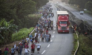 Honduran migrants heading to the US walk along the road in Huixtla, Chiapas state, Mexico, on Wednesday 24 October