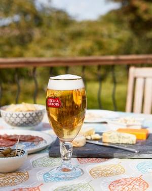 A glass of Stella Artois on a garden table