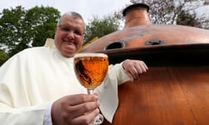Father Karel Stautemas poses with a Grimbergen beer in the courtyard of the Belgian Abbey of Grimbergen