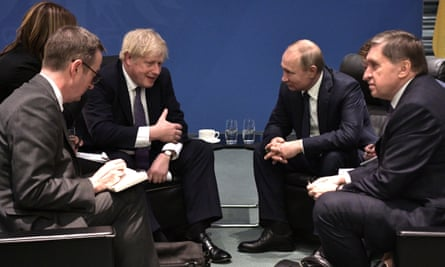 Johnson talking as Putin listens in a group of four seated men