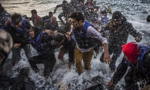 Migrants arrive on Lesbos having made the crossing from Turkey