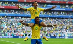 Brazil's Neymar celebrates with Paulinho after opening the scoring.