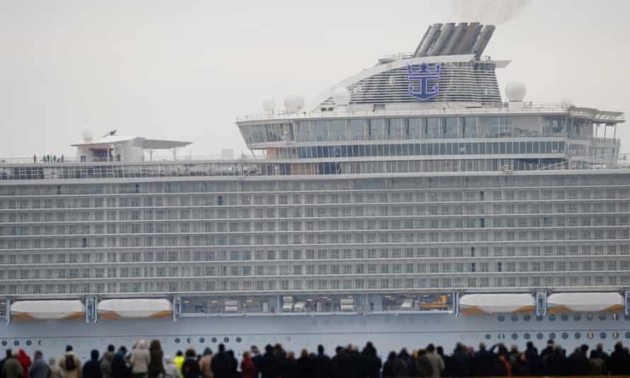 Crowds watch as the massive ship leaves the STX Les Chantiers de l'Atlantique shipyard.