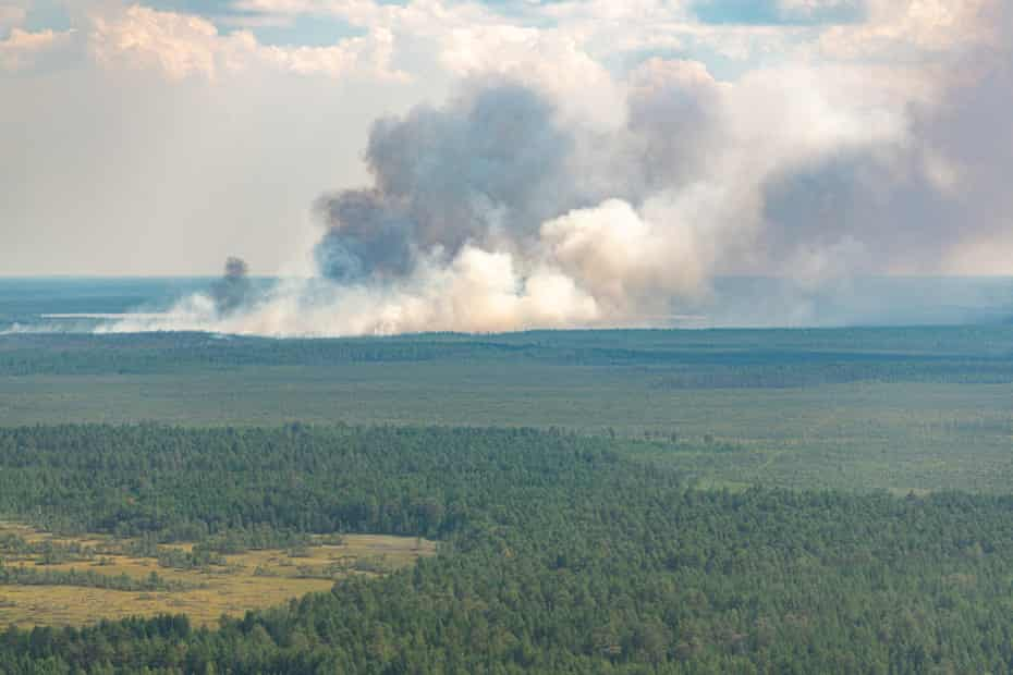 An aerial view of a wildfire in the taiga in the Khanty-Mansi Autonomous Area, in north-west Siberia. The boreal forests of Siberia are under attack from higher temperatures.