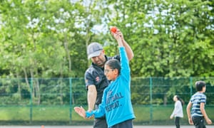 Farouk Hussain, Chance to Shine coach, with with pupil Abdul Rahman Mulla at Audley Infant School, Birmingham