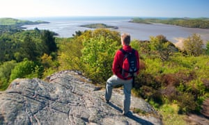 Hiker looking at view of rocks and water