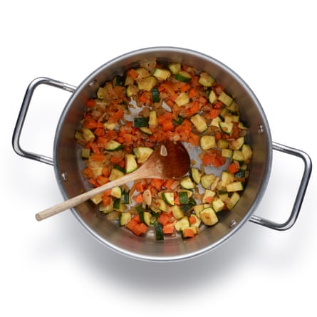 1 Fry the onions gently in a little oil for 10 minutes, then add the other chopped vegetables, and some herbs