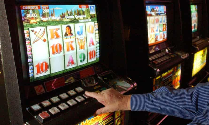 A punter playing the poker machines
