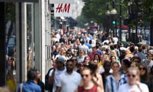 Shoppers walk along Oxford Street