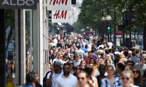 Shoppers walk along Oxford Street in London