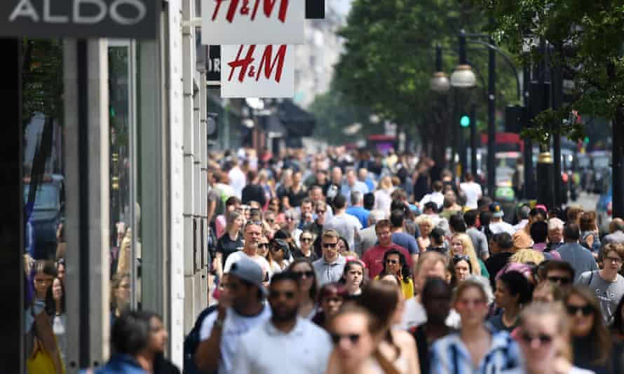 Shoppers walk along Oxford Street in London.
