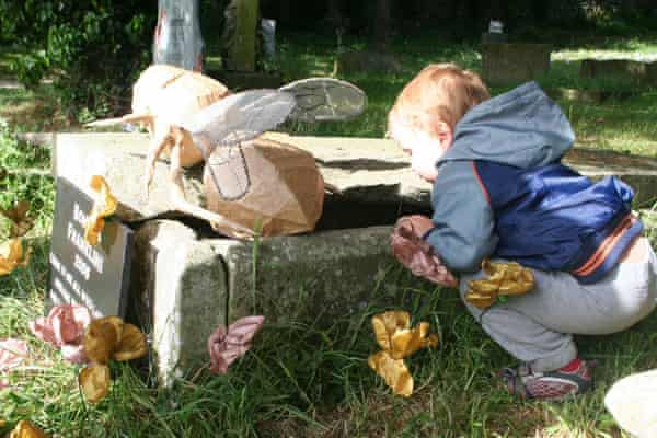 A child visits the 'grave' of Bombus franklini, a bee that went extinct in 2006, during the Funeral for Lost Species. The memorial was made by Eri Meacock.
