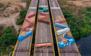 Shipping containers block the Tienditas Bridge, which links Venezuela and Colombia