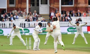 James Anderson celebrates taking the wicket of India's Umesh Yadav.