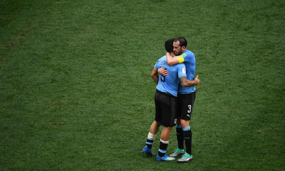Luis Suárez, left, and Diego Godín react embrace after the defeat to France in the World Cup quarter-final.