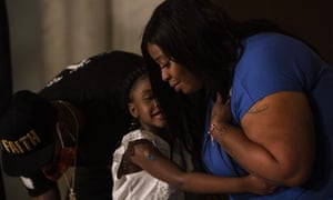 Roxie Washington embraces her daughter Gianna Floyd at a press conference on 2 June 2020 in St. Paul, Minnesota.