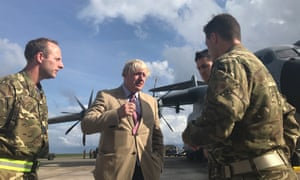 British foreign secretary Boris Johnson with the pilots of an RAF aircraft and Royal Marines in Barbados, where he stopped on his way to visit British overseas territories ravaged by Hurricane Irma.