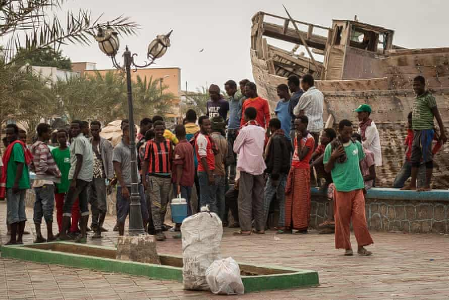 Ethiopians who have run out of money wait at the docks in the town of Tadjoura, en route to Obock, in the hope of securing casual employment