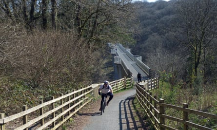 Looking south at cyclists on Drake's Trail National Cycle Network Route 27 in Devon.