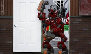 Team Tartan Rescue's Chimp robot walks through a doorway during the finals of Darpa's Robotics Challenge.