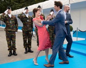 Belgian Prime Minister Charles Michel (R), his partner, Amelie Derbaudrenghien, and Canada's Prime Minister Justin Trudeau arrive for a dinner
