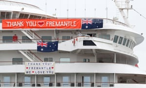 A crew member looks on as the Artania prepares to depart Fremantle harbour on Saturday