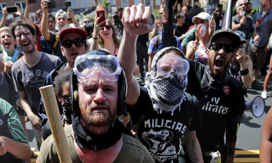 Anti-fascist counter-protesters seen outside Lee Park in Charlottesville, Virginia on 12 August. White nationalists and neo-Nazis were forced to leave the park when their Unite the Right rally was declared an unlawful gathering.