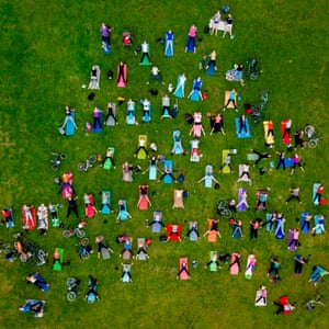 Open air: people on mass yoga exercise in the central park of Vilnius, Lithuania