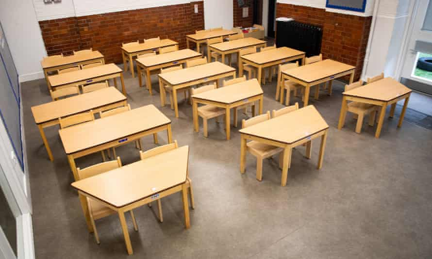 Tables and chairs spaced for physical distancing in a classroom