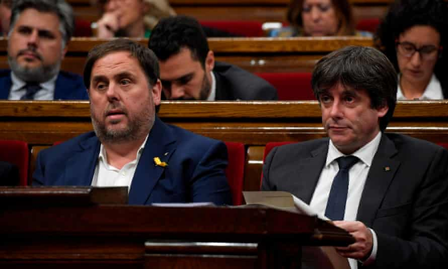 The Catalan president, Carles Puigdemont, right, and vice-president, Oriol Junqueras, attend a session at the Catalan parliament in Barcelona on Thursday.