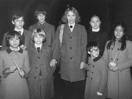 Mia Farrow with (back row from left) Matthew, Sascha, Soon-Yi and (front row from left) Daisy, Fletcher, Moses and Lark, in 1984.