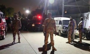 Security officials at the scene of the attack in Karachi on Saturday