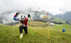 A grass skier stretches himself during a free practice at the Grasski World Championships in Marbach, Switzerland.