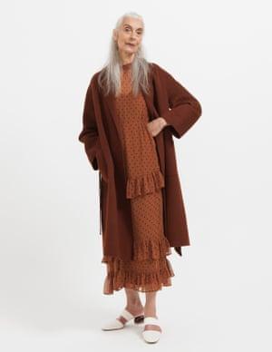 model  wears dress, £49.99, zara.com. Coat, £280, jigsaw-online.com. Mules, £350, neous.co.uk. Earrings, £55, jcrew.com.