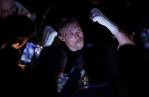 Oleksandr Usyk celebrates with fans as he walks back to the changing rooms after beating Anthony Joshua in their World Heavyweight title boxing fight.