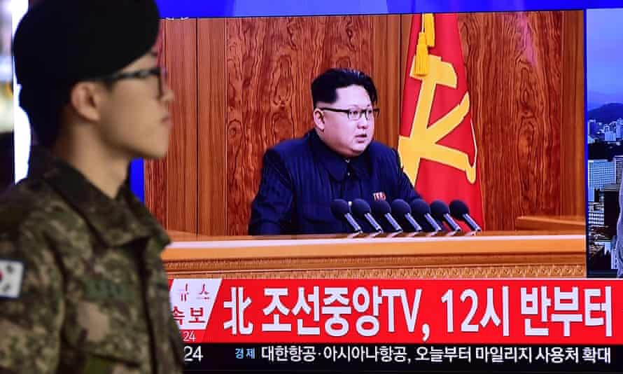 A television screen shows a broadcast of North Korean leader Kim Jong-Un's New Year speech, in which he threatened war if provoked by outsiders.