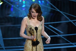 Emma Stone delivers a speech on stage after she won the Best Actress award for her work in La La Land