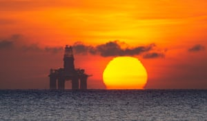 Fife, Scotland The sun rises behind a redundant oil platform moored off Kirkcaldy, as oil prices remain under pressure