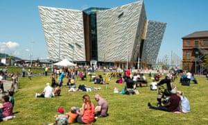 People sit outside the Titanic Museum.