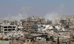 Smoke billows from buildings during an operation by Syrian government forces to retake control of Leramun, on the north-west outskirts of Aleppo.