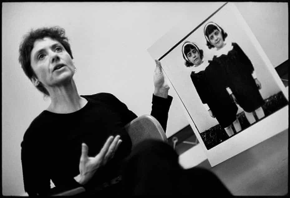 Diane Arbus with her photograph Identical twins, Roselle, NJ 1966, during a lecture at the Rhode Island School of Design in 1970.