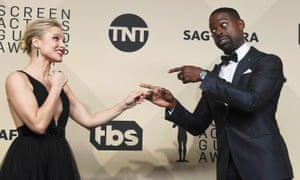 Kristen Bell with Sterling K Brown, who won best actor in a drama series for This Is Us